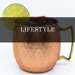 Lifestyle products, moscow mule mugs in copper. Hand made. Whisky stones in natural stone, comes in three colors; dark grey, sand and red.