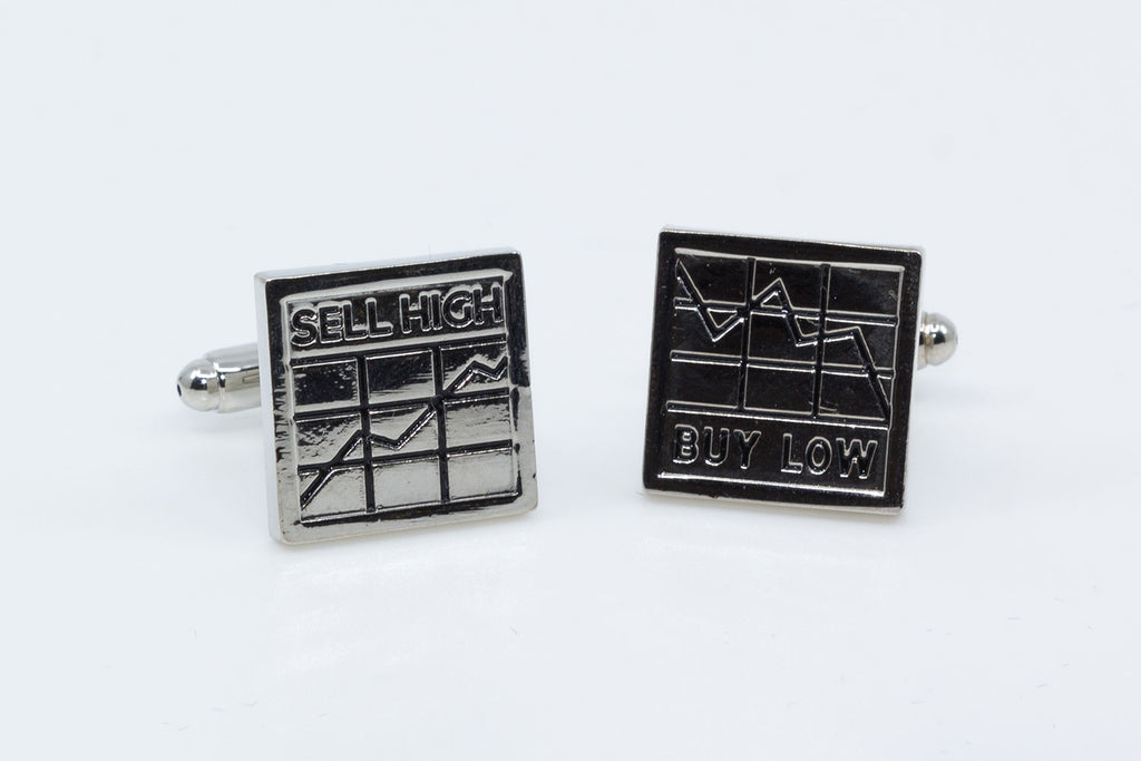 "Cufflinks the Stockbroker - picturing two graphs in silver and black with one cufflink saying ""Buy Low"" and one saying ""Sell High"""