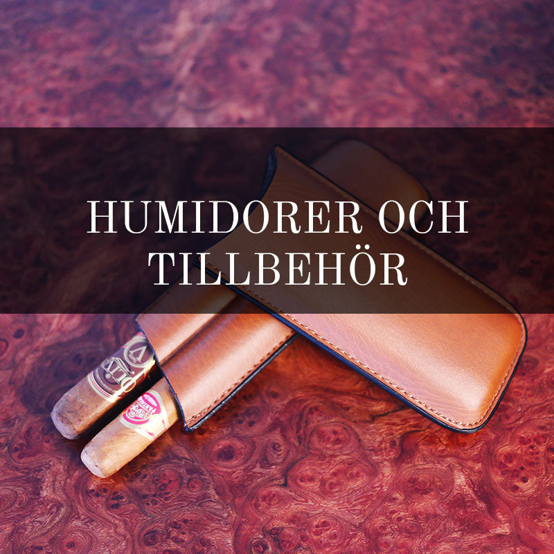 Humidors in Spanish cedar wood, walnut and mahogany. Genuine leather cigar case. Fold-able ashtray in wood.