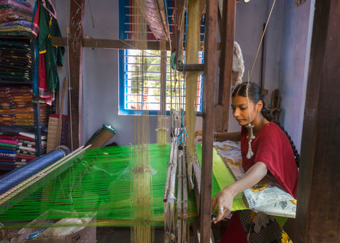 Artisan working on Hand loom