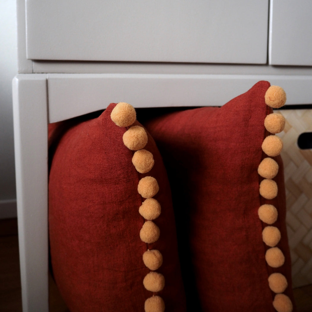 'Limited Edition' PomPom cushion, terracotta