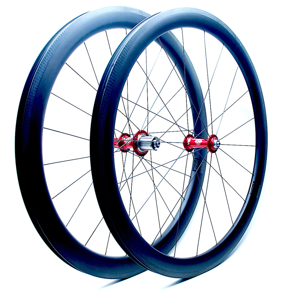 Will's Tailwind Carbon Hoops on Red Anodised White industries T11 hubs