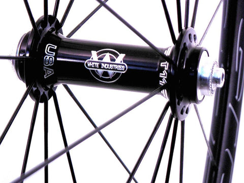 XLR8 wheels custom handmade HED road tubeless bicycle wheels using White Industries T11 hubs and Sapim Spokes. Photo of front hub.