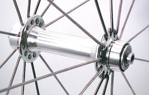 Photo of BikeHubStore Polished hubs rebuilt onto Kinlin XC279 polished rims. Front hub imaged.