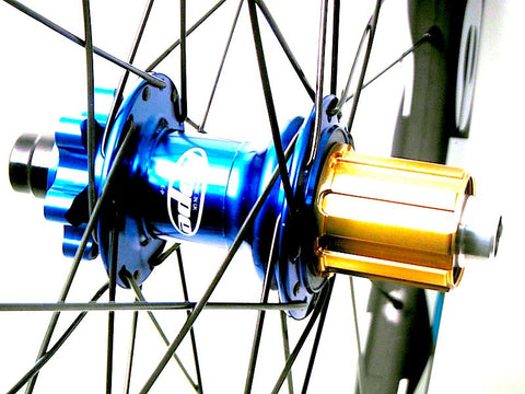 Image of blue Hope Pro2 Evo MTB hubs built onto Zelvy Carbon MTB wheels by XLR8.