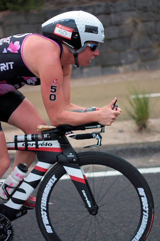 Image of Christie Sym Triathlon Pro riding XLR8 Wheels.