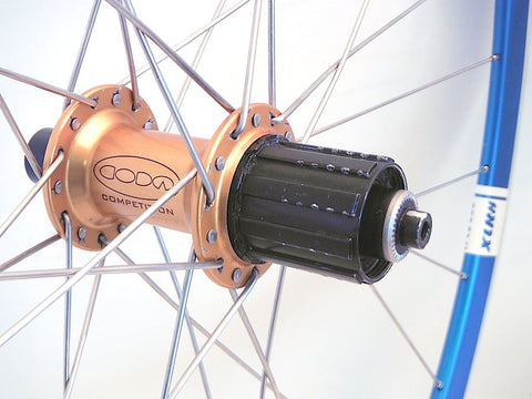 Photo of Cannondale Coda DT Swiss 240 hubs custom hand built road cyclocross or gravel bike wheels built onto Velocity Deep V rims by XLR8. Rear hub pictured.
