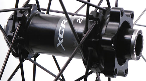 Image of custom Carbon MTB rim rebuild on Giant DT Swiss Hubs. Front hub pictured.