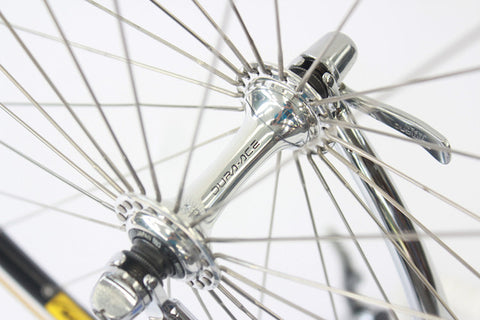 Image of 1990 Colnago Master racing bike restoration with custom retro handmade XLR8 wheels. Front Dura Ace 7400 hub shown.