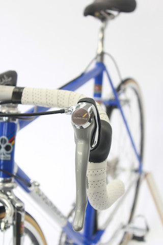 Image of 1990 Colnago Master racing bike restoration with custom retro handmade XLR8 wheels. Front quarter profile shown.