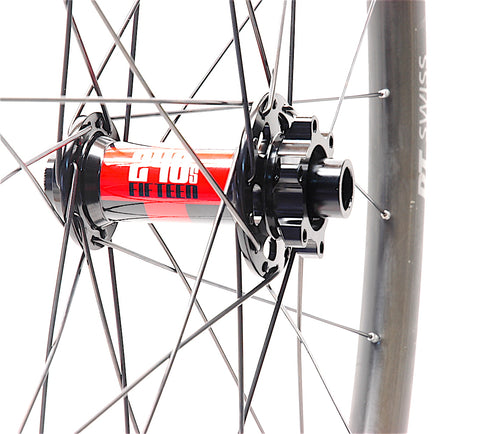 DT Swiss 240s hub laced into a carbon rim by XLR8 Performance Bicycle Wheels front hub