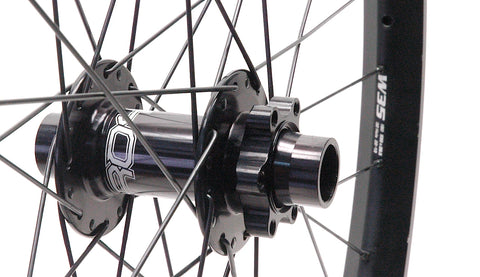 Hope MTB hubs rebuilt onto Syntace W35 wide alloy rims, by XLR8 Performance Bicycle Wheels. Front hub and rim shown.