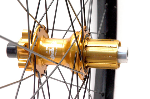 Hope MTB hubs rebuilt onto Syntace W35 wide alloy rims, by XLR8 Performance Bicycle Wheels. Rear hub and rim shown.