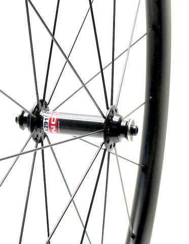 Nextie NXT45RT tubular carbon road rims laced onto Powertap Pro and Novatec hubs by XLR8 Performance Bicycle Wheels - side view