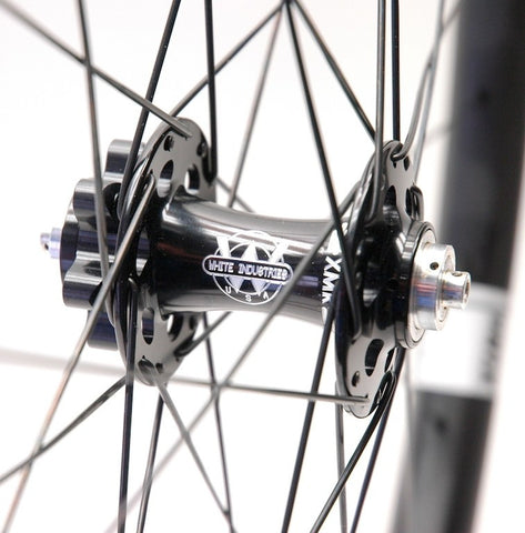 XLR8 wheels custom handmade 29 inch carbon 35mm wide tubeless MTB wheels using White Industries XMR and Eno Eccentric disc hubs. Photo of front hub.
