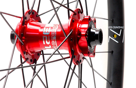 Nextie Asymmetirc 30mm wide carbon 29er rims on Project 321 Red Boost hubs by XLR8 Performance Bicycle Wheels front hub