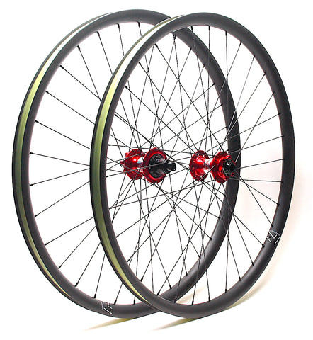 Nextie Asymmetirc 30mm wide carbon 29er rims on Project 321 Red Boost hubs by XLR8 Performance Bicycle Wheels angled