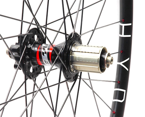 Hplusson THE HYDRA gravel disc road rims on Novatec MTB hubs by XLR8 Performance Bicycle Wheels rear hub