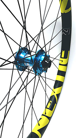 Project 321 Turquoise hubs on Nextie Premium Carbon rim by XLR8 Performance Bicycle Wheels front