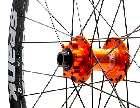 Spank 350 Vibrocore on Hope Pro4 Orange Front by XLR8 Performance Bicycle Wheels
