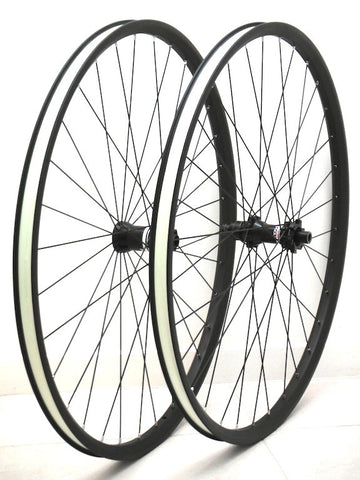 Photo of Specialized Roval 29er wheels rebuilt with Light Bicycle Carbon rims by XLR8 Wheels.