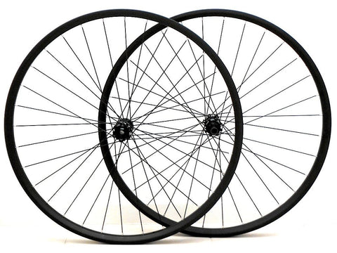 Photo of Specialized Roval 29er wheels rebuilt with Light Bicycle Carbon rims by XLR8 Wheels. Pair of wheels shown side on.