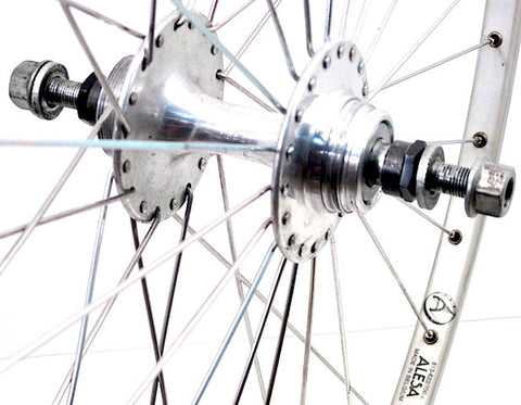 Image of retro track fixie wheel restoration by XLR8 wheels using Suzue hubs and Alesa silver rims.
