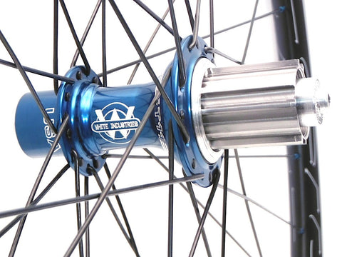 Photo of XLR8 custom road bicycle wheel build of White Industries T11 rear Blue hub on HED Belgium+ tubeless ready rims.