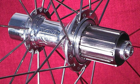 Image of White Industries T11 Polished Rear hub with Titanium 11 speed Shimano freehub.