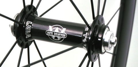 Picture of XLR8 Mistral T55 and T90 carbon tubular triathlon or time trial rim custom built with black White Industries T11 hubs. Front hub shown.