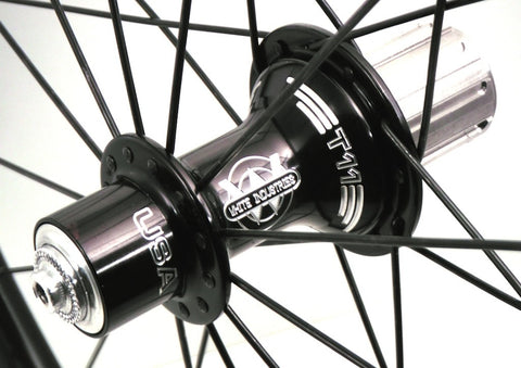 Picture of XLR8 Mistral T55 and T90 carbon tubular triathlon or time trial rim custom built with black White Industries T11 hubs. Rear hub pictured.