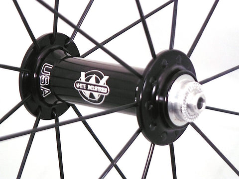 Photo of XLR8 Mistral T38 tubular carbon rims custom road bike racing wheels with White Industries T11 hubs in black. Image shows front hub.