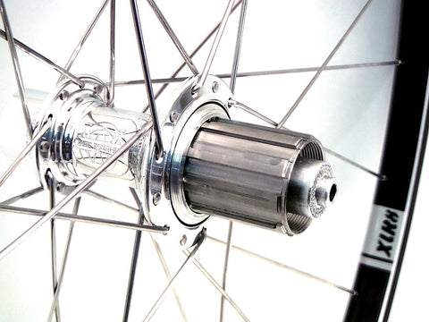 Photo of handmade custom bike wheels using White Industries T11 on Velocity A23 tubeless rims.