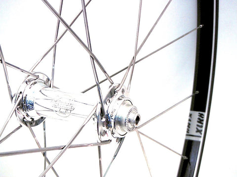 Photo of handmade custom bike wheels using White Industries T11 front hub on Velocity A23 tubeless rims.