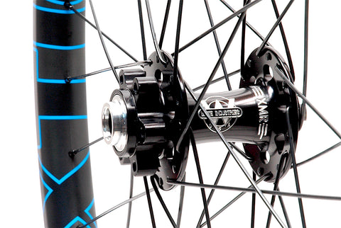 White Industries XMR front hub on Nextie Premium Carbon rims angled by XLR8 Performance Bicycle Wheels