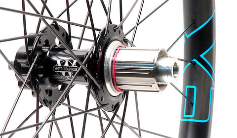 White Industries XMR rear hub on Nextie Premium Carbon rims angled by XLR8 Performance Bicycle Wheels