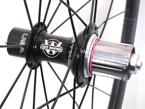 Photo of XLR8 Mistral T38 tubular carbon rims custom road bike racing wheels with White Industries T11 hubs in black. Image shows rear hub.