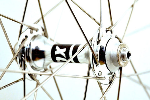 Photo of XLR8 wheels custom retro bicycle road wheels on Rouleur rims. Front hub rebuilt and regreased.