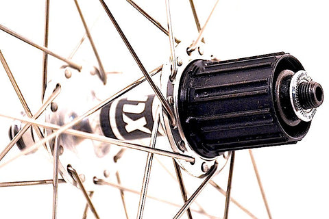 Image of XLR8 wheels custom retro bicycle road wheels on Rouleur rims. Rear hub rebuilt and regreased.
