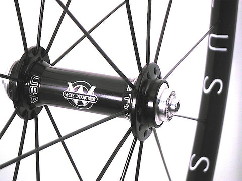 Photo of custom XLR8 Wheels road bicycle wheels using White industries T11 hubs on Hplusson Archetype rims. Front hub shown.