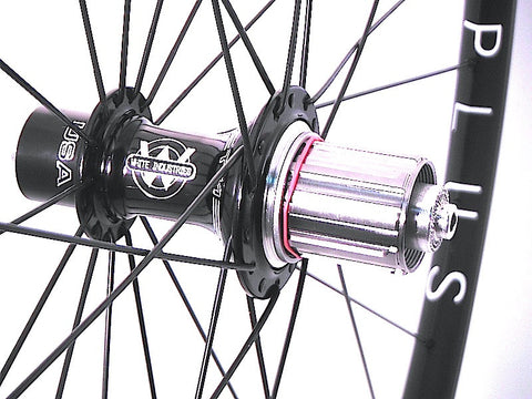Photo of custom XLR8 Wheels road bicycle wheels using White industries T11 hubs on Hplusson Archetype rims. Rear hub shown.