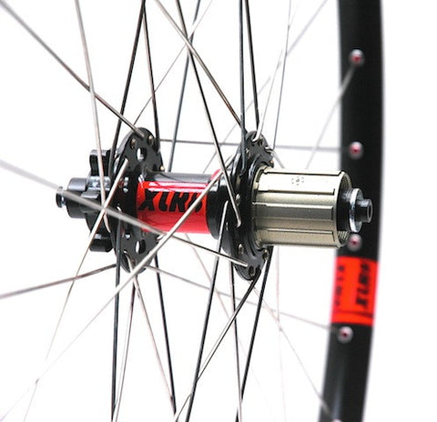 Image of custom alloy MTB XC and Trail wheelset using DT Swiss 370 front hub, XLR8 MD MTB rear hub, and Alex Evo 2.3 rims. Pic shows rear hub.