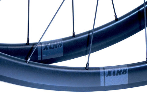 Photo of XLR8 Mistral T38 tubular carbon rims custom road bike racing wheels with White Industries T11 hubs in black. Image shows decals.