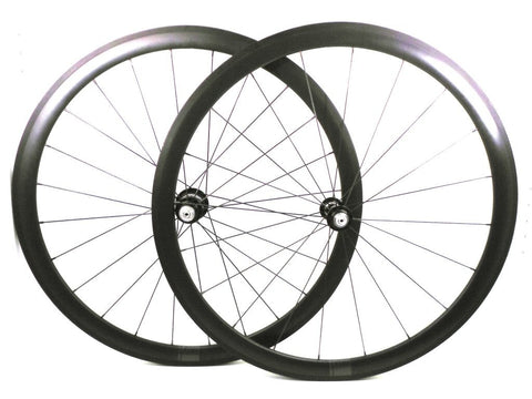 Photo of XLR8 Mistral T38 tubular carbon rims custom road bike racing wheels with White Industries T11 hubs in black. Image shows both wheels.