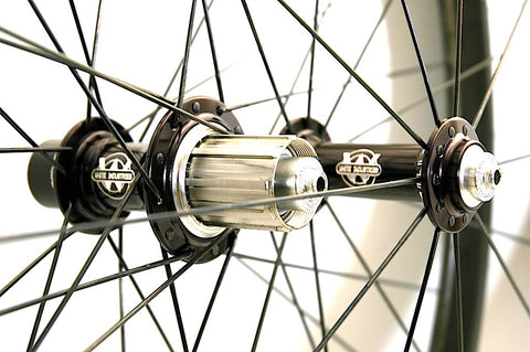 Photo of Reynolds Forty Six Carbon clincher rebuild by XLR8, using White Industries T11 hubs and Sapim spokes.