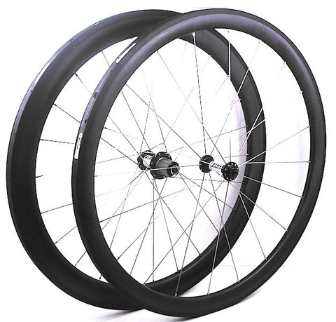 Picture of XLR8 wheels custom carbon road triathlon wheelset, using XLR8 MD hubs and 38mm and 50mm deep and 28mm wide toroidal tubeless clincher rims.