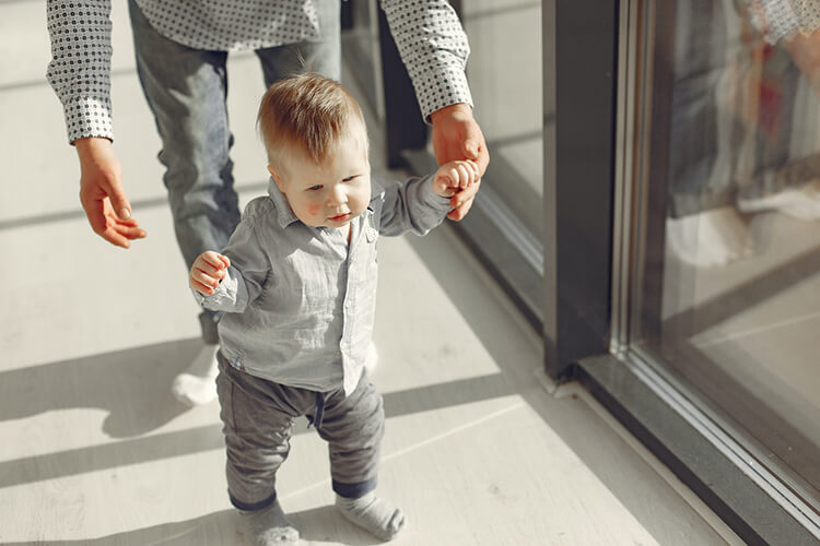 baby walking with support