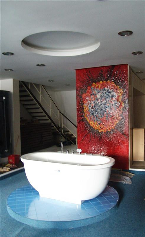 red flower mosaic art installed in bathroom