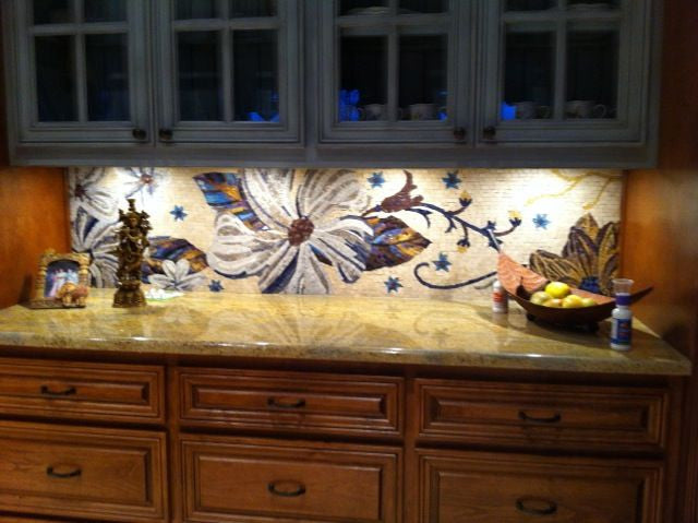 floral mosaic installed as kitchen backsplash