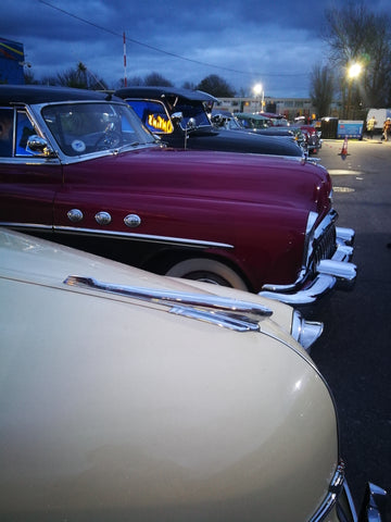 Rhythm Riot classic 1940s vintage American cars in twilight
